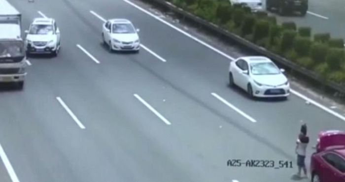 Couple Holding Baby Almost Get Killed By Oncoming Car (5 pics)