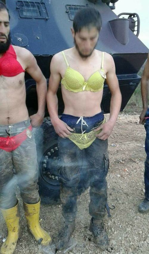 Turkish Military Detains Crossdressing Group Of Syrians (5 pics)