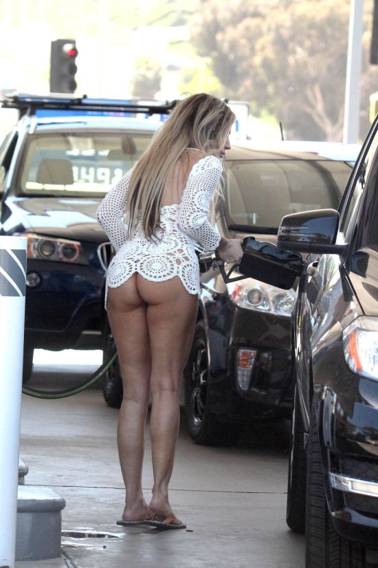 Playboy Model Ana Braga Pumps Gas While Wearing Next To Nothing (5 pics)