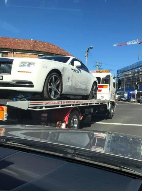 Rich Guy Buys Special Cage For His Rolls-Royce Then Wrecks It (2 pics)