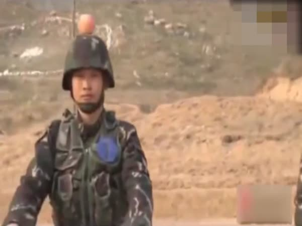 Chinese Soldiers Are Forced To Let Comrades Shoot Apples Off Their Heads