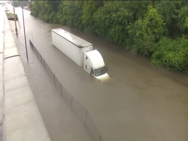 Journalist, Rescuers Save Truck Driver From Flood Waters