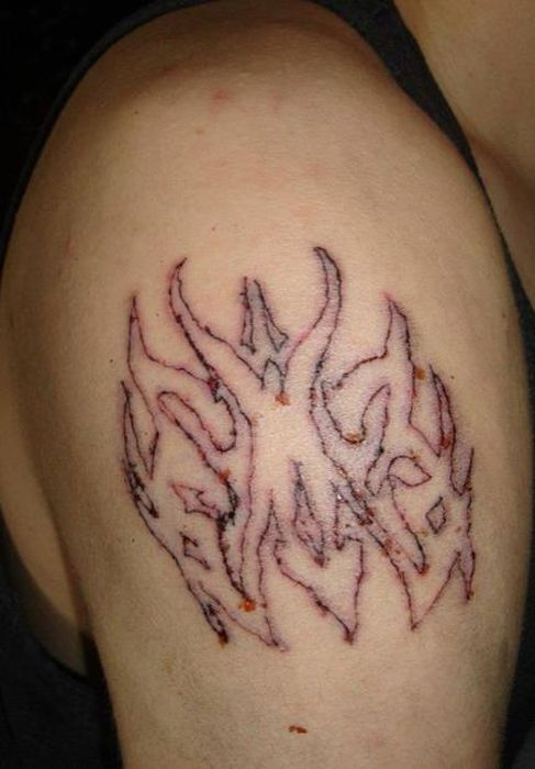 The Worst Tattoo Artist Ever (14 pics)