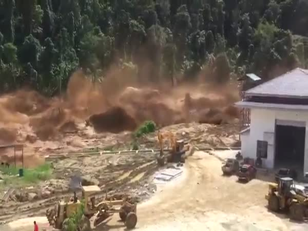 Footage Of a Massive Dam Failure In Laos