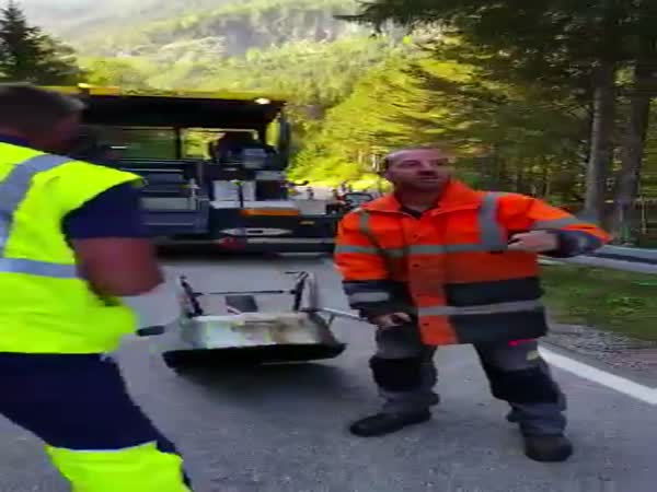 Wheelbarrow Gets Launched Into Air By Road Workers