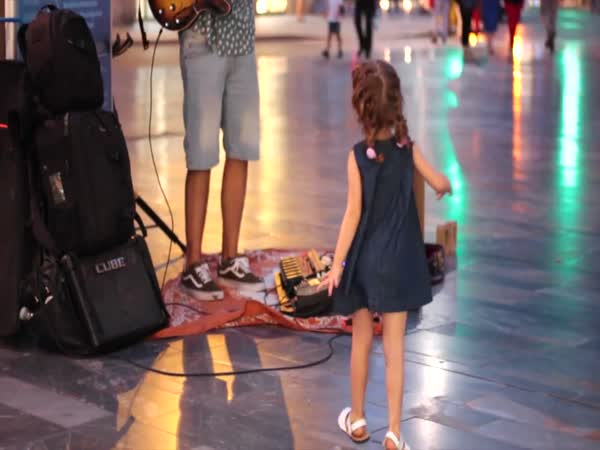 Little Girl Stuns Street Musician With Her Dance