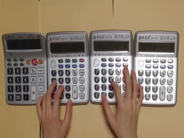 Super Mario Theme Played by Four Calculators