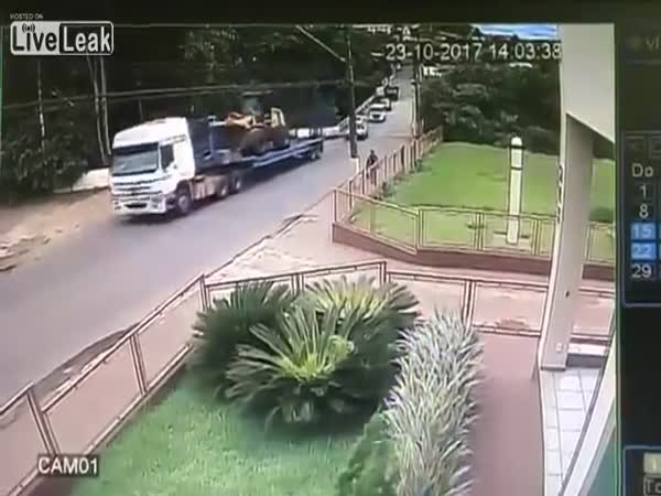 Front Loader Rolls Off The Back Of The Truck Into A Ravine