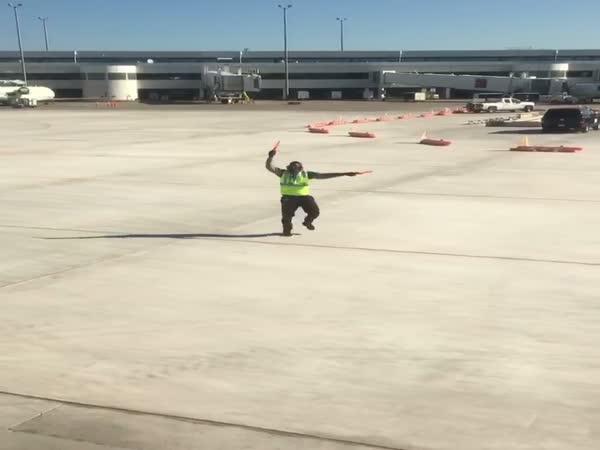 Airport Employee Dancing on The Tarmac
