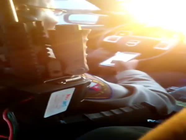 Cop Caught Texting While Driving By Detainee In Back Seat