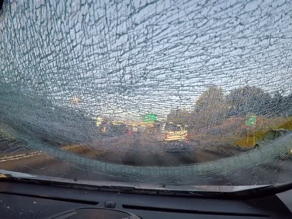 Car Tire Smashes Windshield