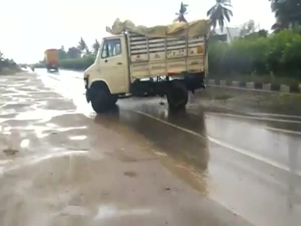 Truck Loses Control on Wet Road