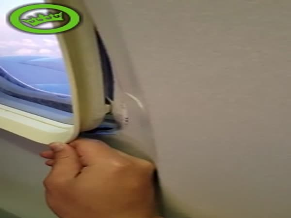 Broken Plane Window Having to be Held in Place by Passenger During Flight