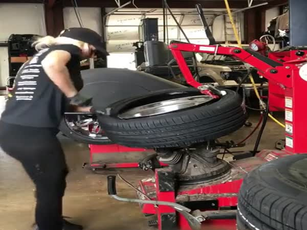 Sexy Girl is Changing Tire at Tire Service