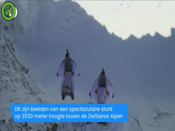 2 Wingsuit Flyers Base Jump Into a Plane in Mid-Air