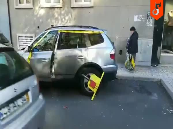 Driver Removes A Parking Wheel Lock Without The Key