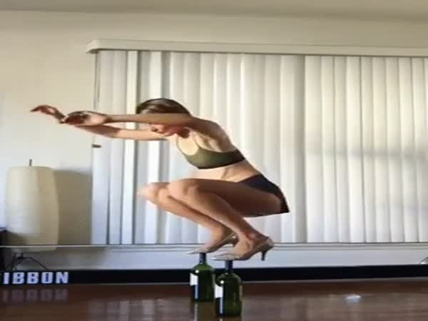 Girl Shows Of Amazing Bottles Balancing Trick