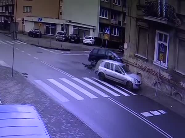 Pedestrian Nearly Crushed Between Two Cars