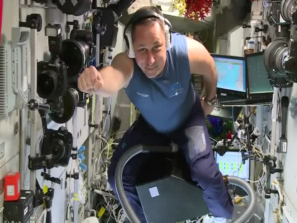 ISS Cosmonaut Rides Vacuum Cleaner Like a Horse in Space