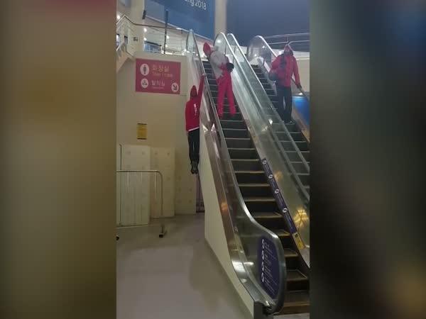 Winter Olympics Skier's Unusual Way Of Using An Escalator