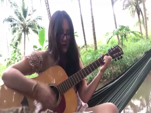 Girl Playing Guitar Breaks a String