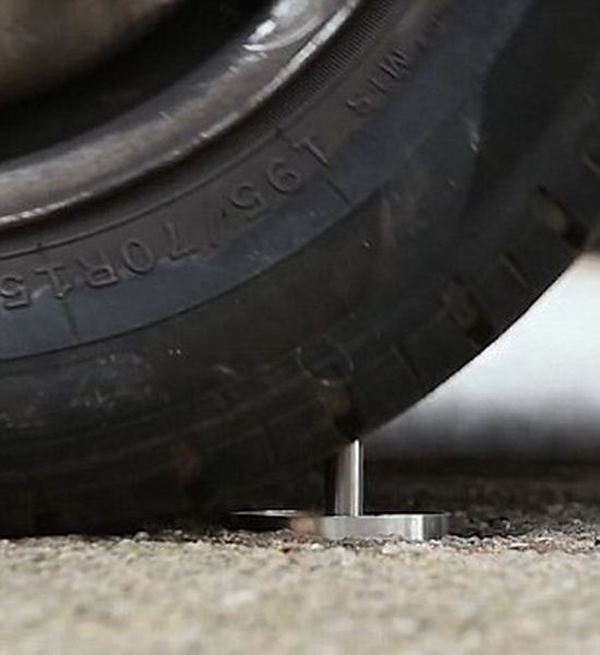 CatClaw Gives Cars Flat Tyres By Puncturing Them With A Sharp Steel Spike (5 pics)