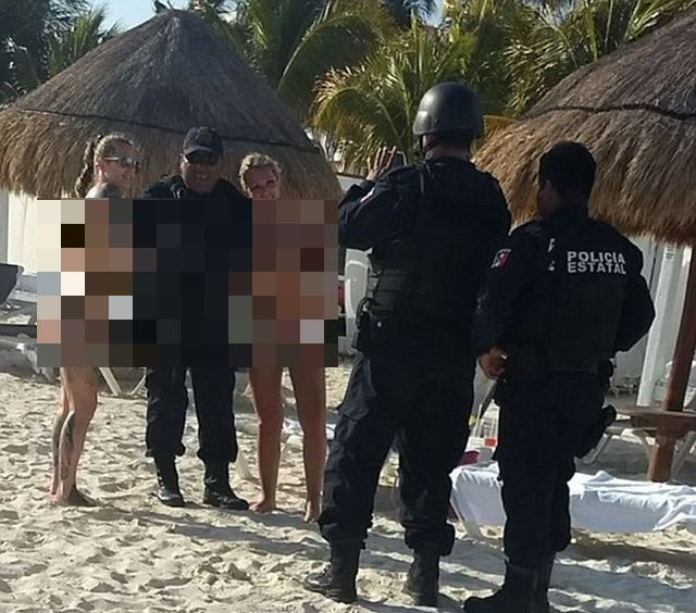 Cancun Cops Are Suspended After Posing With Topless Tourists (3 pics)