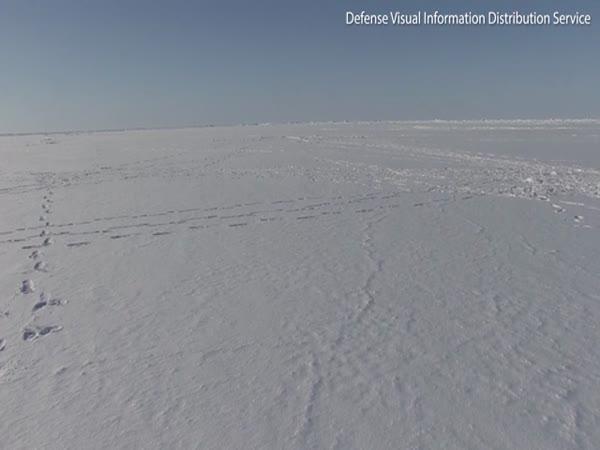 U.S. Naval Submarine Smashes Through The Ice In The Arctic Ocean