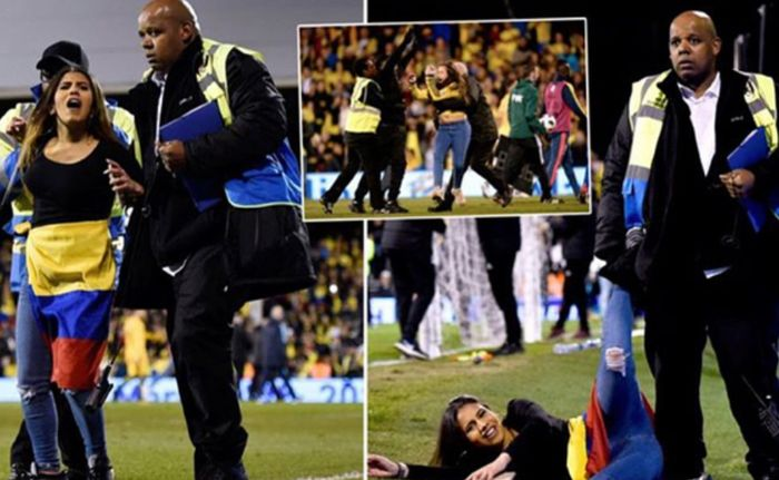 Girl Interrupts Colombia vs Australia Game (4 pics)