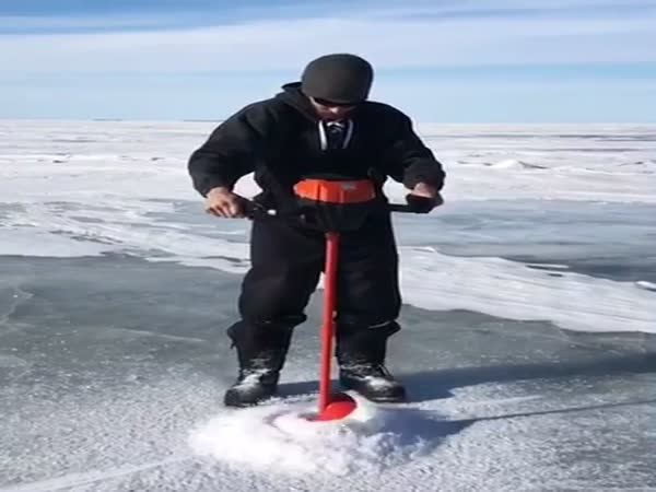 Drilling Frozen Ice in Lake