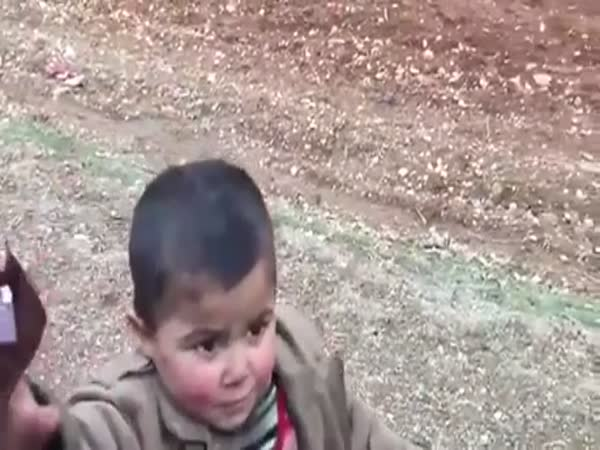 Turkish Soldier Gives Chocolate To Syrian Kid