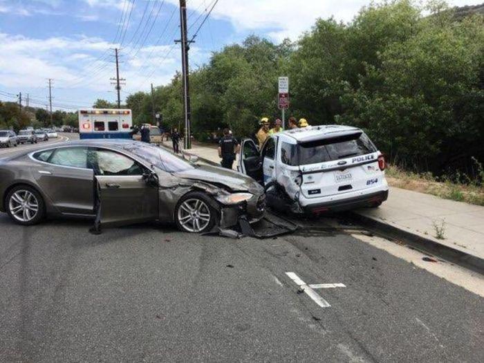 Tesla Autopilot Smashed Parked California Police Ford (3 pics)