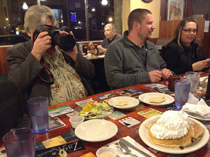 Photos Of People Taking Pictures Of Food (16 pics)