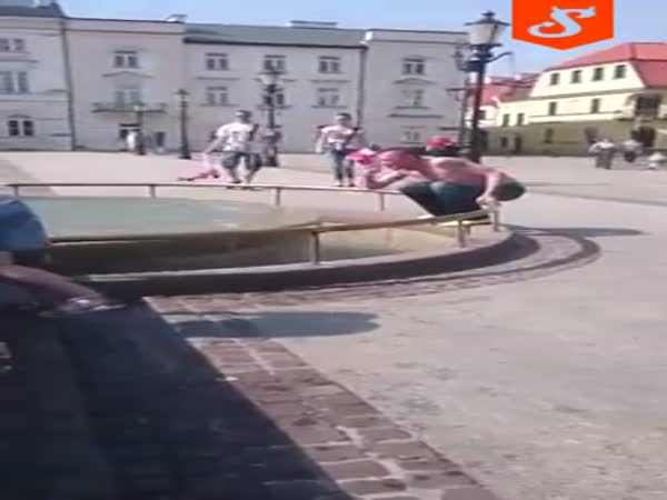 Drunk Guy Jumps in Fountain