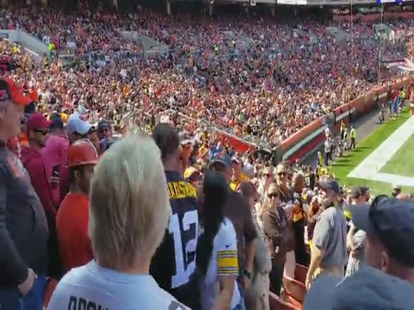 A Steelers Fan Fights Browns Fans During An NFL Game