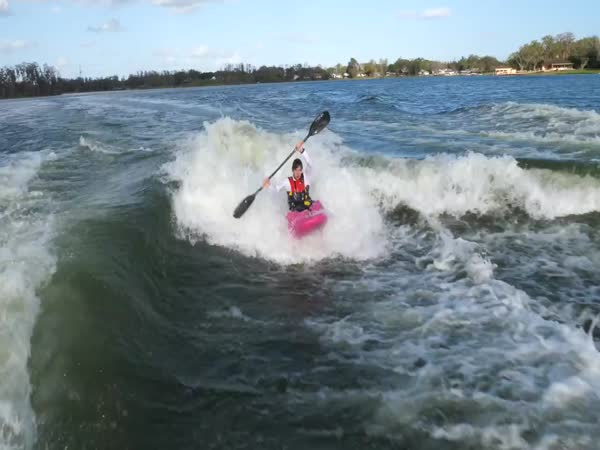 Kayaker Surfing Behind Wakeboats