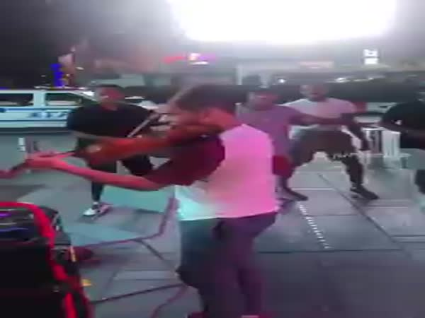 Strangers Dance To A Street Violinist