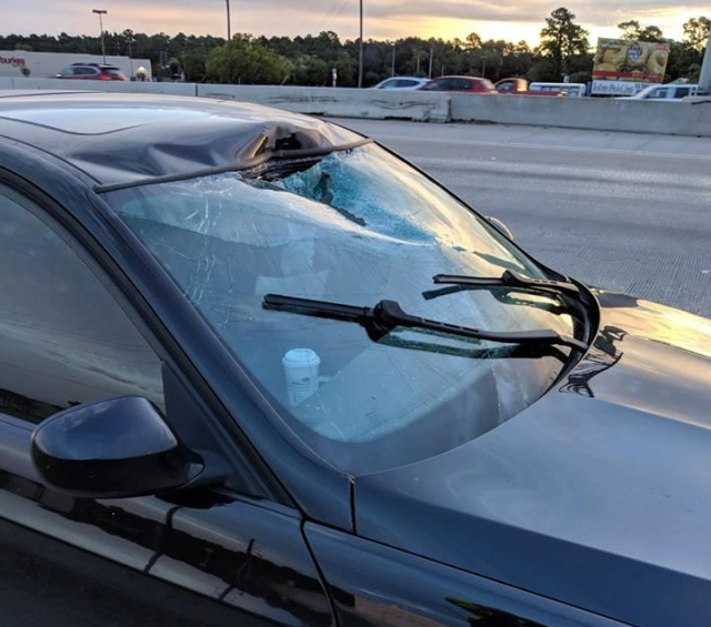 Flying Tow Hitch Hits Car On I-45 (2 pics)
