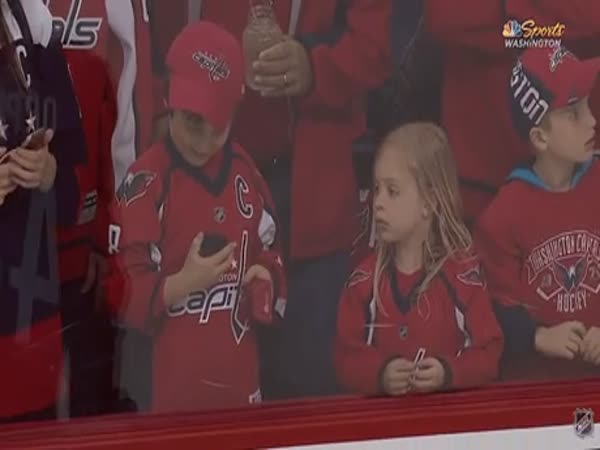 Hockey Player Tries To Give A Puck To A Young Girl