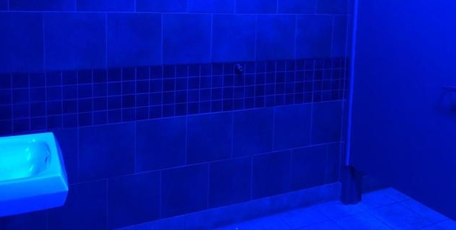 Gas Station Installs Blue Lights To Fight Drug Use (5 pics)