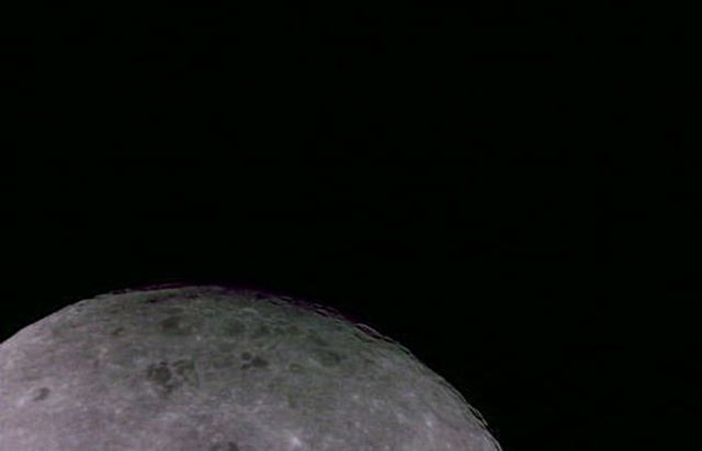 The Far Side Of The Moon With Earth Sitting In The Distance (2 pics)