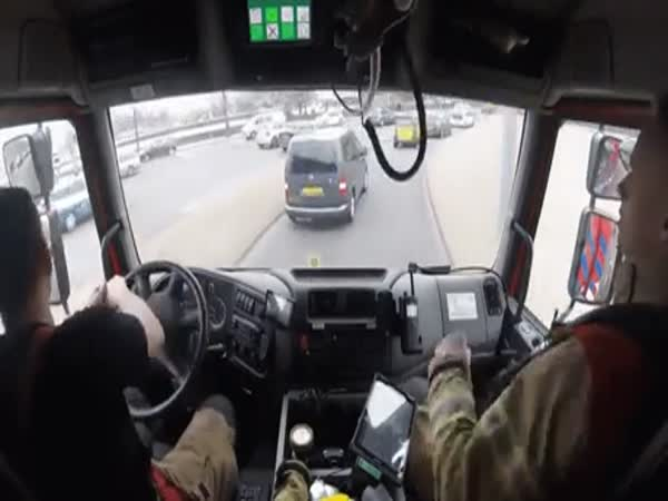 Firefighters Driving To A Scene
