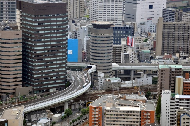Gate Tower Highway In Japan Goes Through The Building (10 pics)