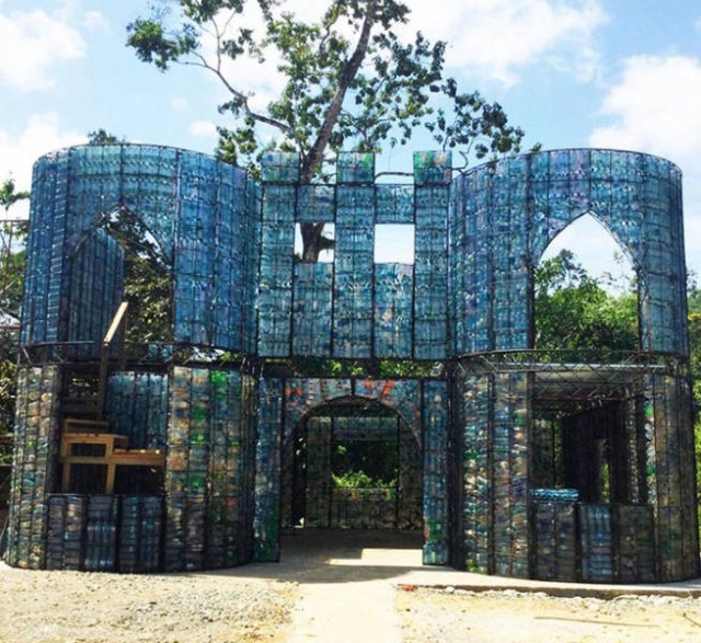 Houses Made Out Of Discarded Plastic Bottles (18 pics)
