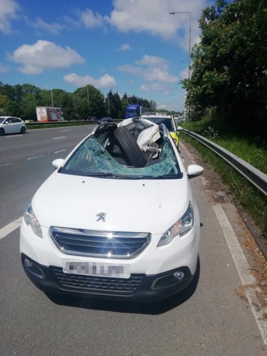 A HGV Wheel Smashes Through A Car Windscreen. The Driver Walks Away (4 pics)