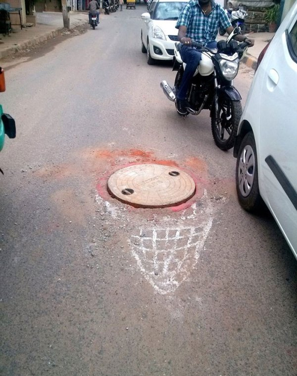 This Man Draws Attention To Road Hazards In Bengaluru, India (19 pics)