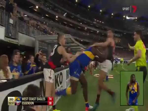 Footy Player Grabs Hair, Gets Choke Slammed Into Fence
