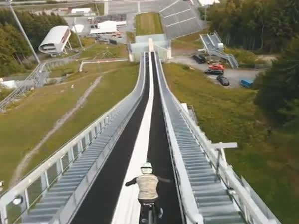 Riding A Bike Down A Ski Jump
