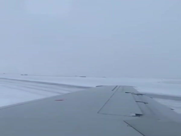 Plane Drifts Off Runway