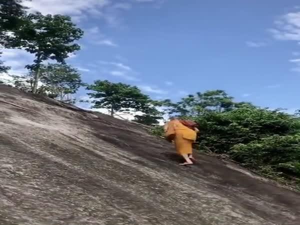 Monk Climbing The Mountain
